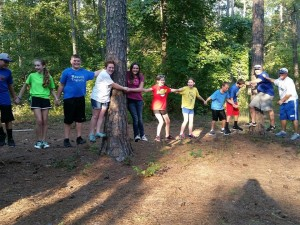 low-ropes-course-holding-hands